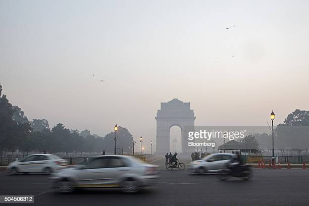 Traffic passes the India Gate monument shrouded in smog in New Delhi India on Monday Jan 11 2016 A 2judge Delhi High Court panel headed by Chief...