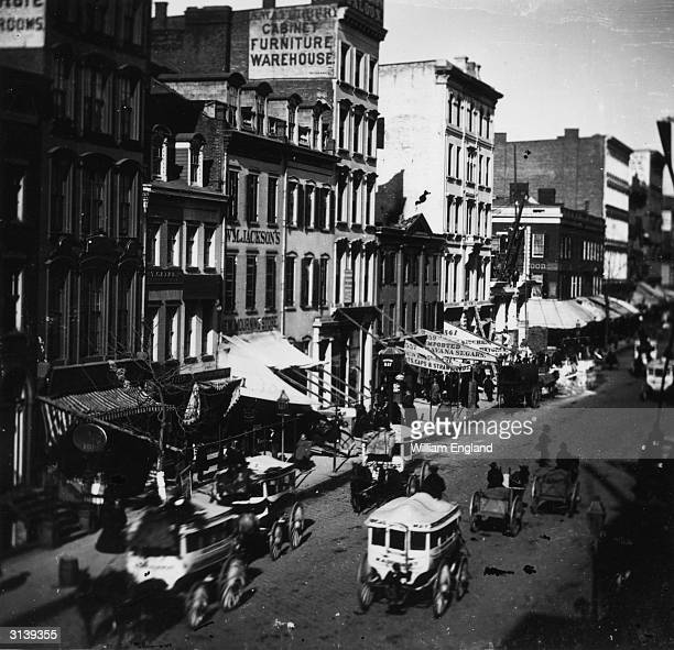 Traffic passes the shops on New York's Broadway