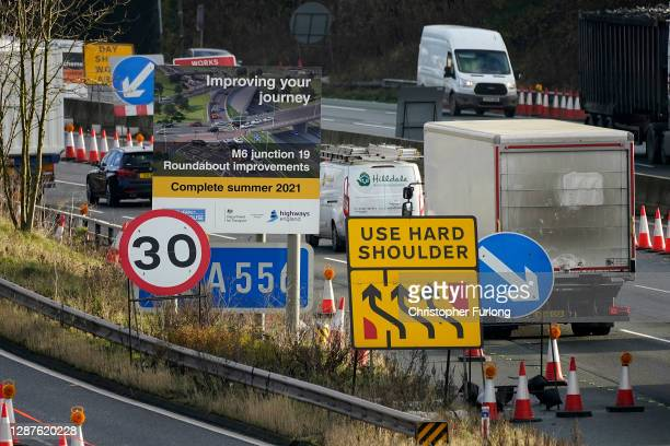 Traffic passes through roadworks and junction improvements at Junction 19 of the M6 motorway on November 25, 2020 in Knutsford, England. Chancellor...