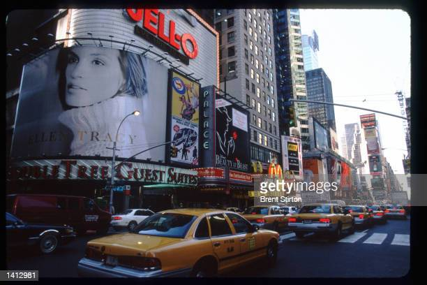 Traffic passes through Times Square November 15, 1999 in New York City. The Times Square area is undergoing a thorough revitalization prior to...