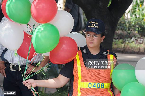 A traffic police agent participates of the inauguration of the Navidad Feliz police operation in Tegucigalpa on December 1 2010 Honduras with 78...