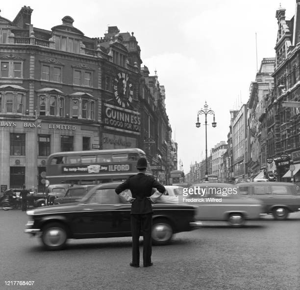 Traffic Police directing traffic on Tottenham Court Road, London, UK, circa 1960.