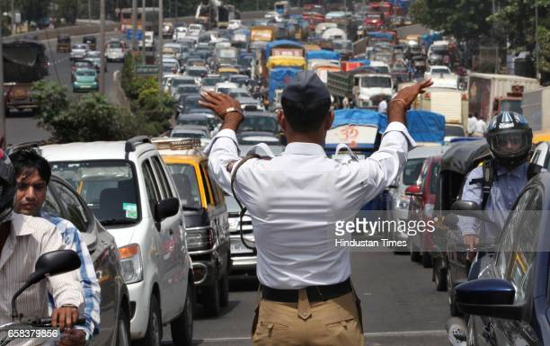 Traffic police diverts the traffic on Western Express Highway after a part of the Dindoshi flyover caved-in in Mumbai, India, on Monday, Sept. 30,...