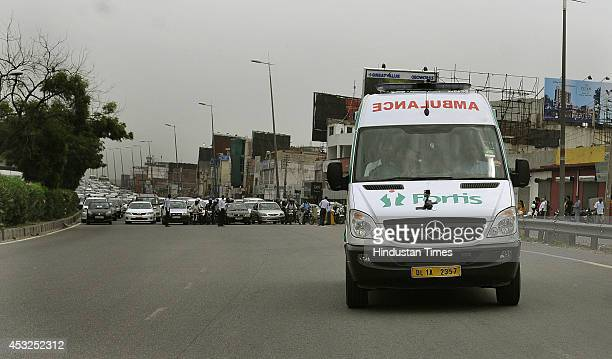 Traffic Police from Delhi and Gurgaon block traffic on NH8 as a Ambulance pass during a trial run of green corridor to transport an organ from the...