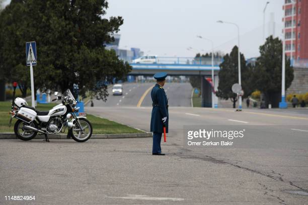 traffic police in north korea - north korea stock pictures, royalty-free photos & images