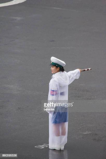 traffic police lady directing traffic in pyongyang north korea - transportation occupation stock pictures, royalty-free photos & images