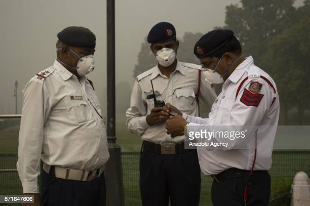 Traffic police officers prepare themselves to perform their duties as the air pollution hit the record level hazardous in Delhi India on November 08...