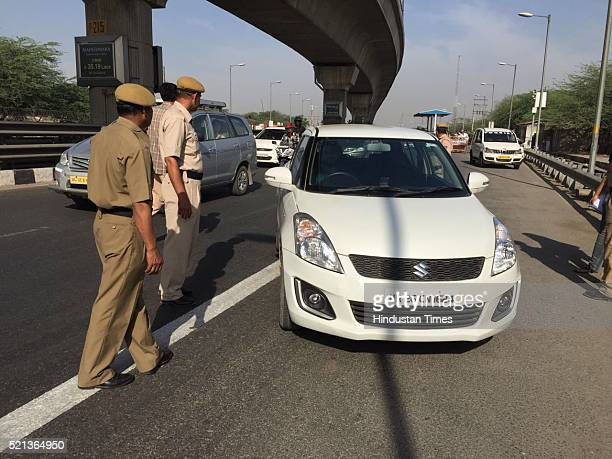 Traffic police officials stop a car bearing an even number plate at DelhiGurgaon border on the first day of the second phase of the oddeven road...