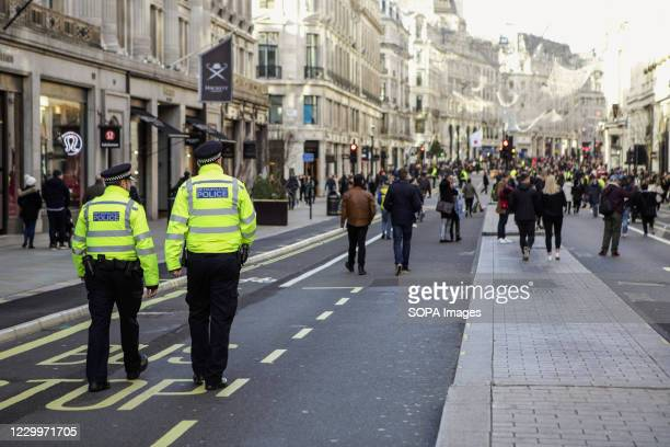 Traffic police seen Patrolling Regent Street. People have started flocking to central London as the capital has been placed in tier 2 on 2nd December...