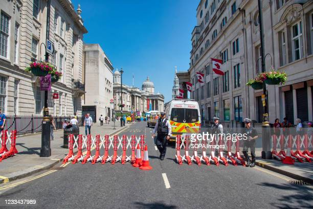 Traffic Police set up road blocks outside the entrance to the UEFA festival London Fan Zone in Trafalgar Square where they can watch England matches...