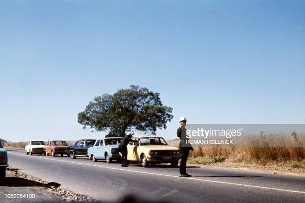Traffic police stop and search all cars near Soweto during a violent protest against having to use Afrikaans language at school 18 June 1976 After...