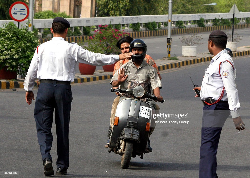 Traffic police try to check the traffic offenders on the Delhi's