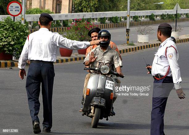 Traffic police try to check the traffic offenders on the Delhi's road as the new fine regime recommended by the Delhi high court came into force