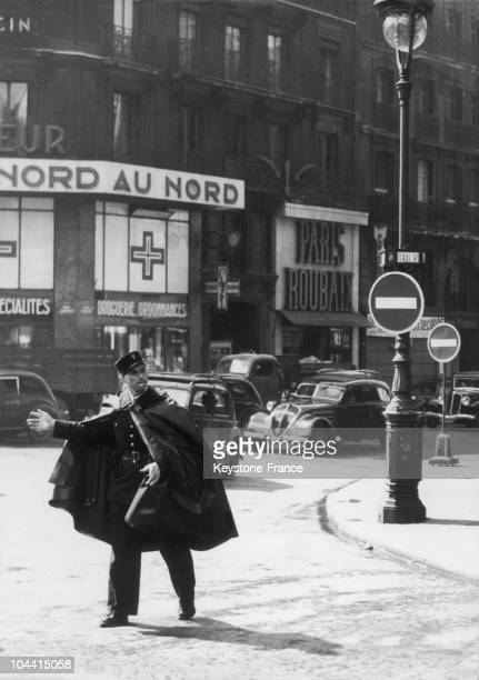 A traffic policeman at the crossroad LafayetteMagenta in Paris