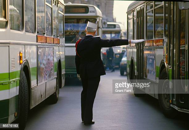 traffic policeman directing bus traffic - traffic police officer stock pictures, royalty-free photos & images