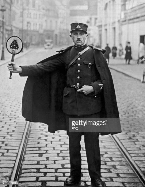 A traffic policeman in the northern French town of Douai with his red light on a stick circa 1925