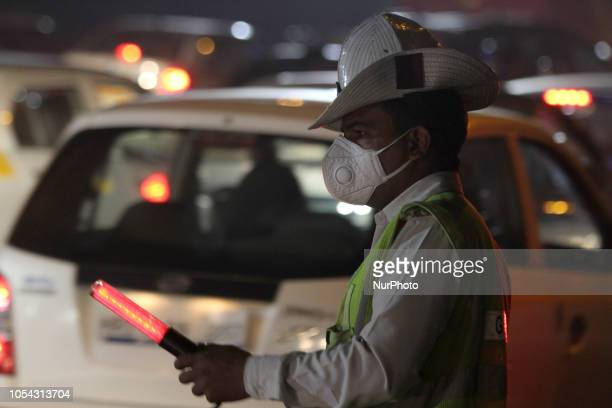 Traffic Policeman wears a mask to protect himself from pollution in delhi NCR India on 27 October 2018.
