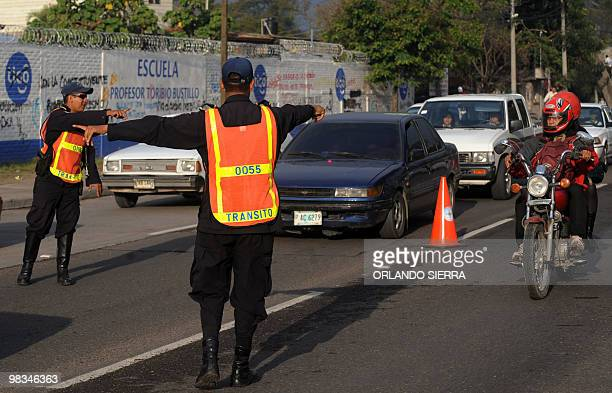 Traffic policemen stop a motorcycle after a new ordenance was approved to prohibit the circulation of two men in the same motorcycle in Tegucigalpa...