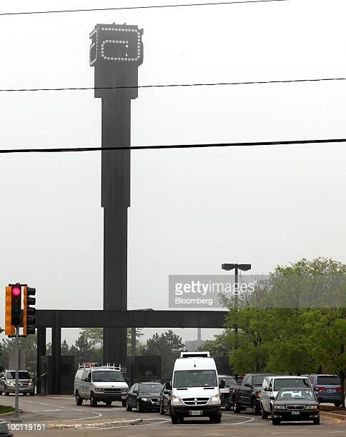 Traffic pulls out of the main entrance of Abbott Laboratories' headquarters in Abbott Park Illinois US on Friday May 21 2010 Abbott Laboratories will...