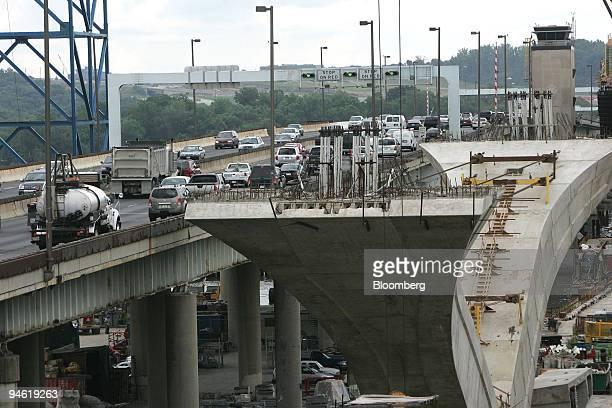 Traffic rolls along on the existing Woodrow Wilson Bridge as construction progresses on the Inner Loop of the new Woodrow Wilson Bridge that will...