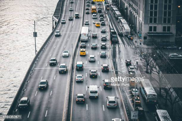 traffic rush hours aerial view - traffic stock pictures, royalty-free photos & images