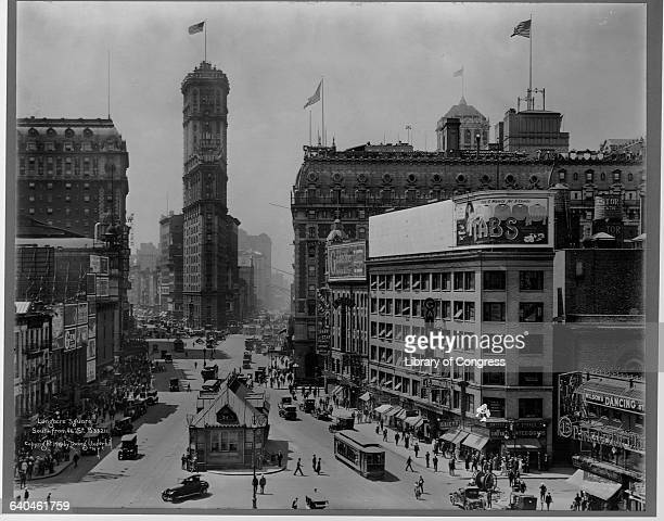 Traffic rushes by the Times Tower and through Longacre Square which would later become known as Times Square ca 1919 New York
