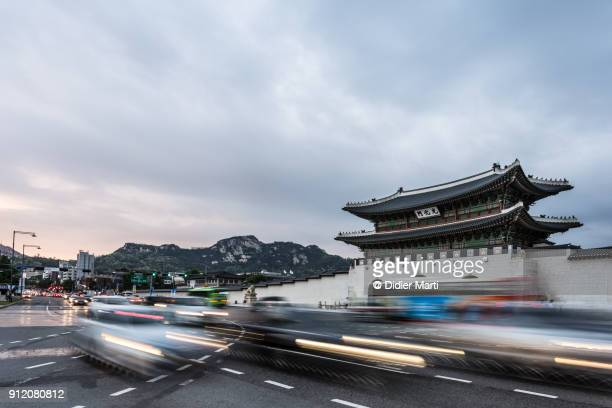 traffic rushing in front of the Gyeongbokgung palace in the heart of Seoul in South Korea