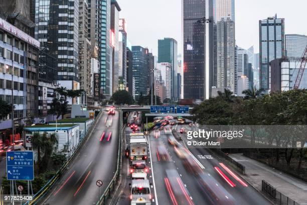 Traffic rushing in the street of Hong Kong island