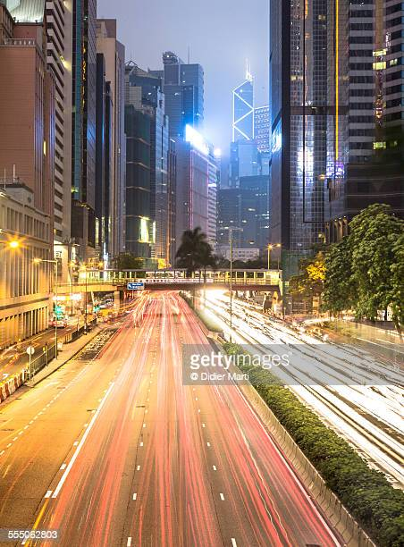 traffic rushing through hong kong - didier marti stock photos and pictures