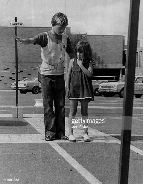 JUL 25 1973 AUG 22 1973 AUG 28 1973 Traffic Safety #2 LR Mark Harvey 14 leads Christine an Rney across the street Young students learn traffic safety...