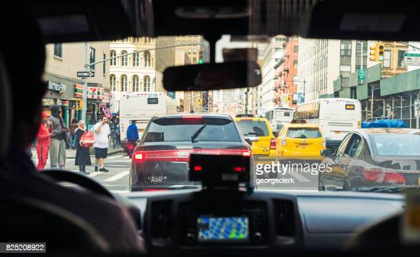 nyc traffic seen from taxi ride - taxi driver stock photos and pictures