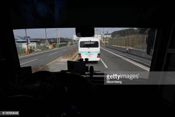 Traffic seen through the windscreen of an autonomous 5G connected bus operated by KT Corp during a media event in Gangneung Gangwon Province South...