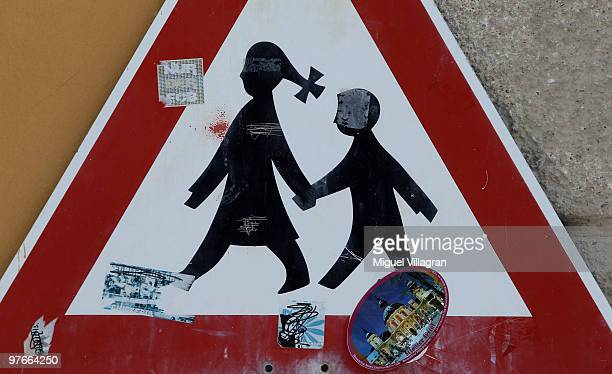 A traffic sign depicting children is pictured at the Benedictinerun Ettal Monastery is pictured on March 12 2010 in Ettal Germany Munich prosecutors...
