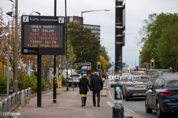 A traffic sign describes the fixture as 'When Harry Met Salah' ahead of the Premier League match between Manchester United and Liverpool FC at Old...