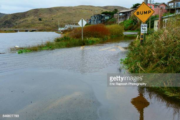 traffic sign on flooded road - california flood stock photos and pictures
