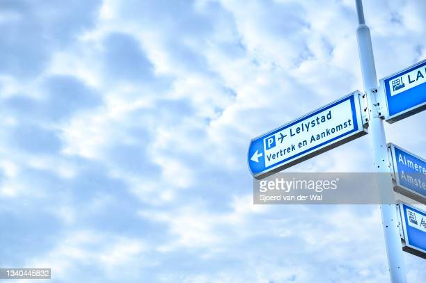 Traffic sign showing the way to Lelystad airport arrival and departures on September 14, 2021 in Lelystad, The Netherlands. The expansion of the...