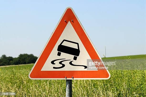 Traffic sign, slippery when wet