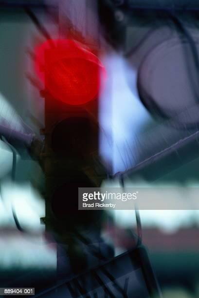 Traffic signal at night, red illuminated (blurred motion)