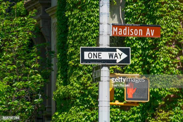 traffic signal stands in front of wall creepers at upper east manhattan new york. - madison avenue stock pictures, royalty-free photos & images