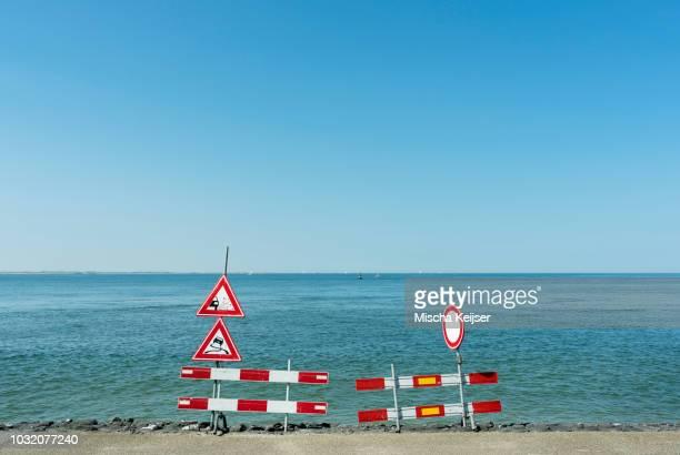 Traffic signs along shoreline