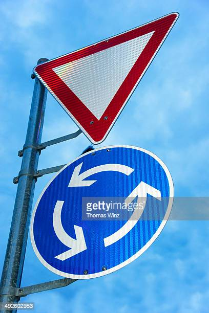 Traffic signs at roundabout