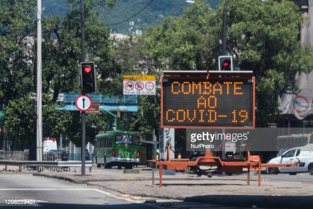 Traffic signs display messages against Coronavirus Covid19 in downtown Rio de Janeiro Brazil on March 25 2020