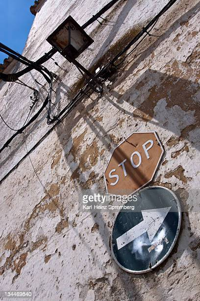 traffic signs on a wall, bornos, andalucia, spain, europe - captions stock photos and pictures