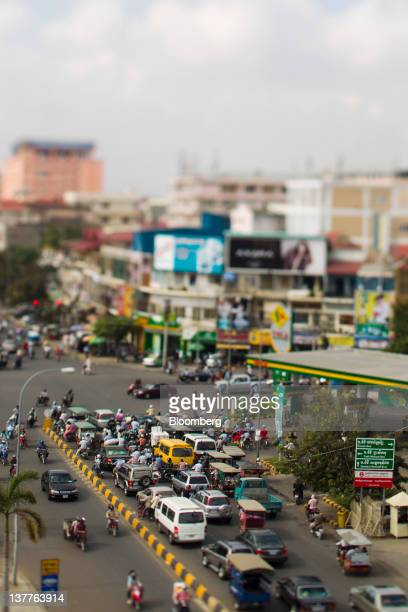 Traffic sits at a light in this photo taken with a tiltshift lens in Phnom Penh Cambodia on Monday Jan 16 2012 Cambodia is likely to open its stock...