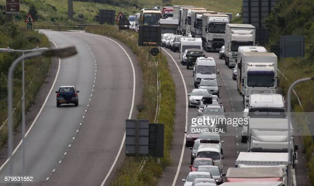 Traffic stands stationary in a traffic jam on the main road leading into the port of Dover just west of the port on the south coast of England on...
