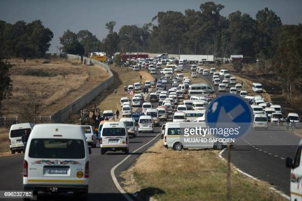 Traffic stands still as South African National Taxi Association members take part in a go slow action in Midrand on June 15 part of a nationwide...