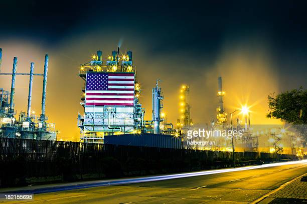traffic streaks and oil refinery - the american dream stock photos and pictures