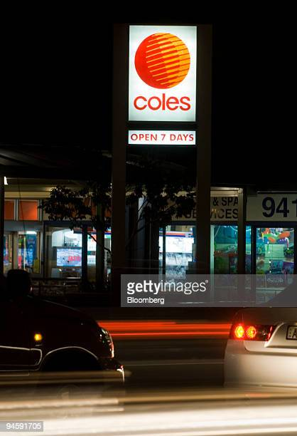 Traffic streams past a Coles Group Ltd supermarket in Sydney Australia on Wednesday May 16 2007 Coles Group Ltd targeted for a takeover by Kohlberg...