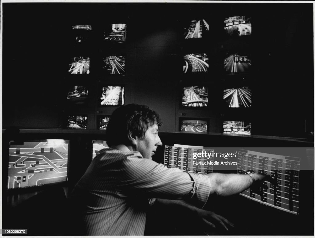 Traffic Supervisor John Cox performs an afternoon lane change on the Harbour Bridge with a few touches of a finger on the TV screens in the Harbour Bridge Traffic Control Centre. The screens are touch sensitive, so all lane switching is done by touching t : News Photo