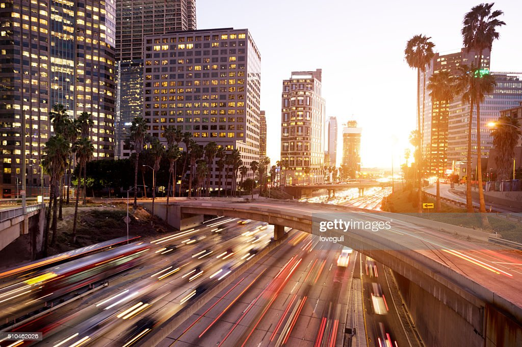 traffic through urban with sunset in los angle : Stock Photo